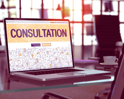 Consultation - Closeup Landing Page in Doodle Design Style on Laptop Screen. On Background of Comfortable Working Place in Modern Office. Toned, Blurred Image. 3D Render.